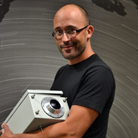 Phil Bland shows off one of the new digital cameras ready to be installed in the Desert Fireball Network.
