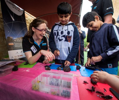 Jay at Fremantle Earth Science Day dissecting meteorites